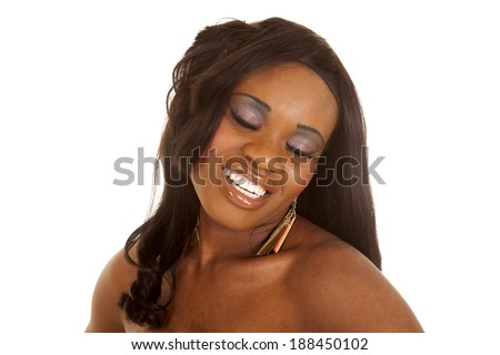 a close up of a woman with her eyes closed and a smile on her lips. - stock photo