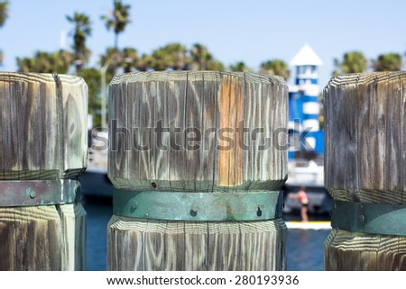 A close up of a wooden support post on a shoreline boardwalk in Redondo Beach California - stock photo