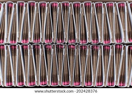 A close up of alternating matchbooks in a box creating a distinct pattern. - stock photo