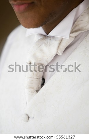 A close up of an african american man wearing a white tie - stock photo