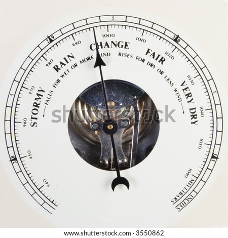 A close up of an aneroid barometer scale pointing to change.