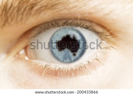 A close-up of an eye with the pupil in the shape of Australia.(series) - stock photo