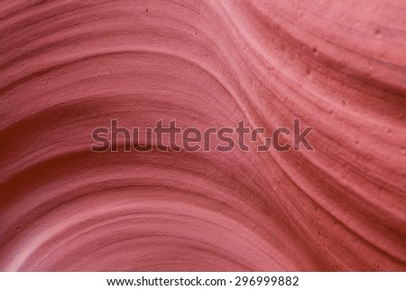 A close up of bright sandstone that has been eroded to a smooth surface over several years in the American Southwest. - stock photo
