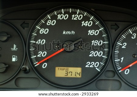 A close up of car dashboard with speed over black background - stock photo
