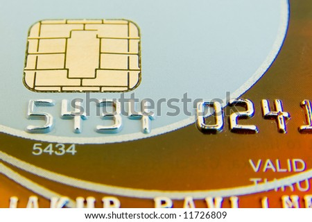 a close-up of credit card with chip and numbers