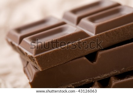 A close-up of delicious chocolate on cream tissue paper - stock photo