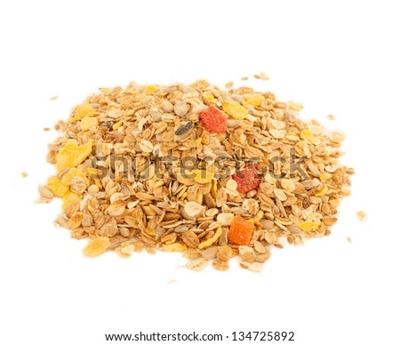 A close up  of delicious healthy muesli with dry bits of pawpaw, pineapple, prunes and raisins - stock photo