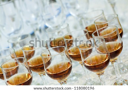 A close up of few  glasses with alcohol drinks - stock photo