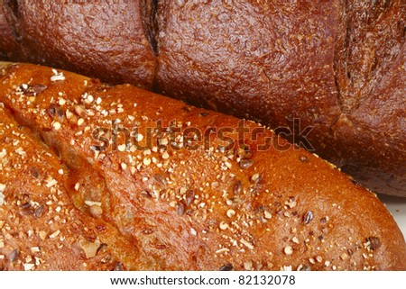 A close-up of five grain and pumpernickel breads - stock photo