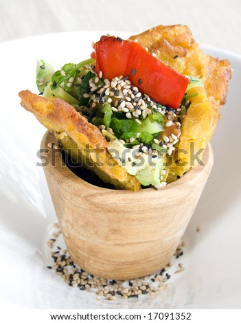 A close up of fried bananas and vegetables. Focus on the red pepper surrounding it. - stock photo