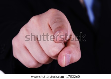 A close up of hand pointing towards camera. - stock photo