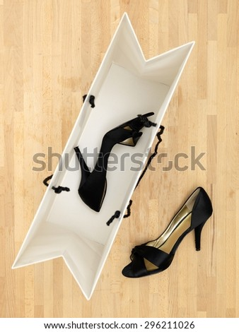 A close up of new ladies high heeled shoes - stock photo