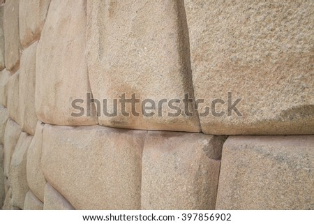 A close up of one of the terraces of stone blocks supporting the hill fortress at Ollantaytambo, the Incan fortification near Cusco in South America - stock photo