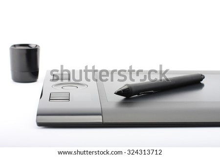 A close-up of  pen on graphic tablet on white background  - stock photo