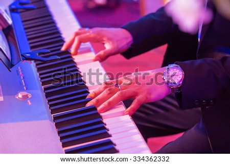 A close-up of playing synthesizer - stock photo