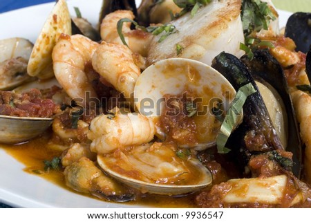 A Close Up of Seafood on a plate on Saffron Rice