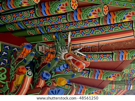 A close-up of the decorative rafters and eaves of a Korean temple. - stock photo