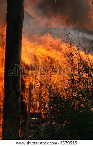 a close-up of the flames of a garage fire - stock photo