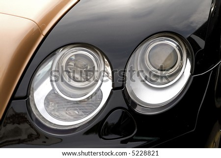 a close up of the headlight luxury car - stock photo