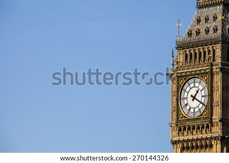 A close-up of the iconic clock tower of the Palace of Westminster in London. - stock photo