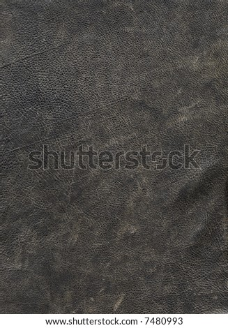 A close-up of the rugged texture of a leather jacket - stock photo