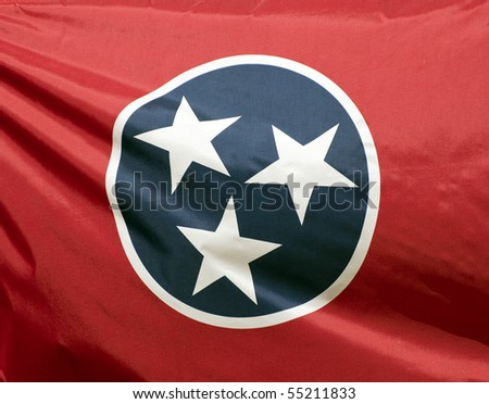 A close-up of the Tennessee state flag waving in the wind. - stock photo