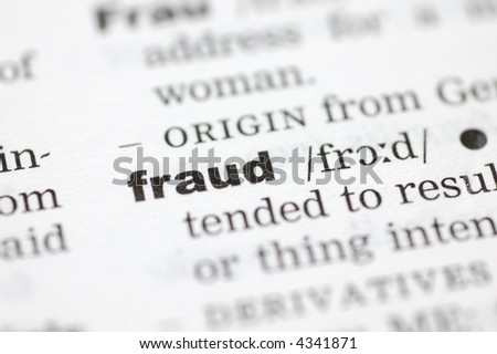 A close up of the word fraud from a dictionary - stock photo