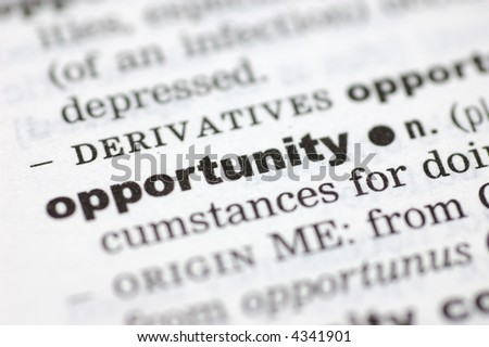 A close up of the word opportunity from a dictionary - stock photo