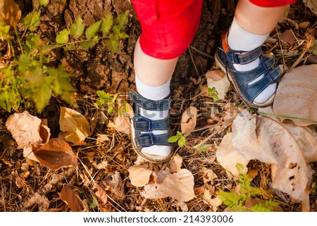 A close-up of tiny baby feet in boots - stock photo