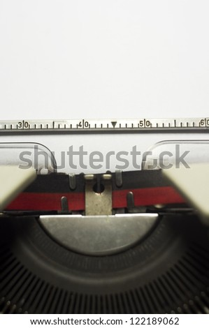 a close up of typewriter, focus on paper where message will be typed. - stock photo