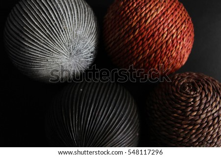 A  close up of wool thread balls on a black background