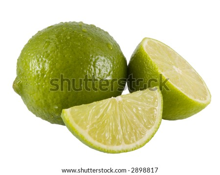 a close up on a fresh limes isolated on a white background - stock photo