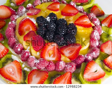 A close up on a fruit dessert with a variety of different fresh fruit with a shallow depth of field.
