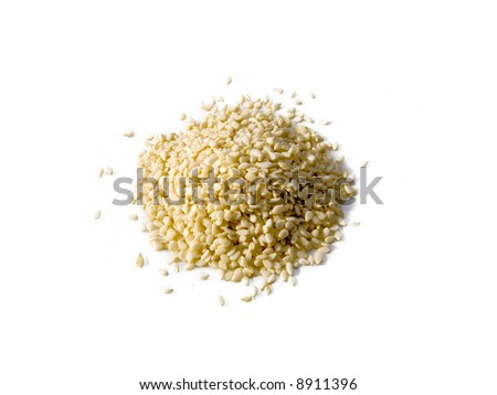 A close up on a pile of dried Sesame Seed isolated on a white background. - stock photo