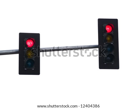 A close up on a red traffic light isolated on a white background. - stock photo
