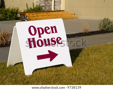 A close up on a sign in front of a house. - stock photo