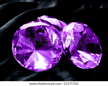 A close up on Amethyst jewels on a dark background. Shallow DOF. - stock photo