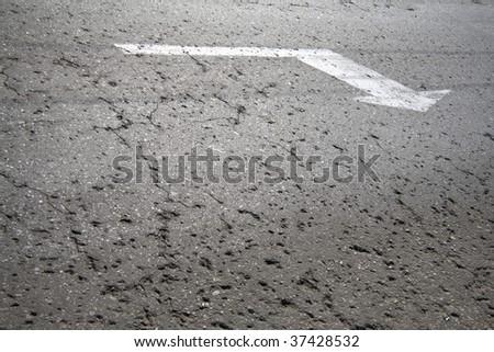 A close up on an arrow on asphalt - stock photo