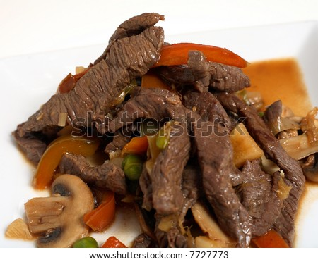 A close-up on Asian-style stir-fried beef. - stock photo