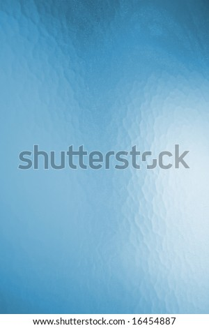 A close up on the texture on privacy glass in a bathroom window. - stock photo