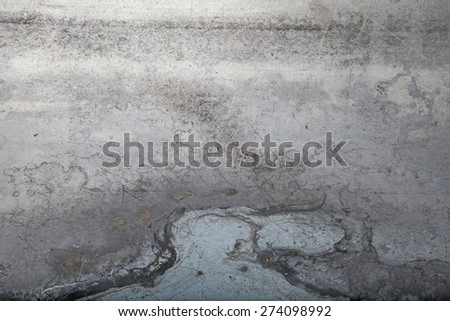 A close up photograph of a textured sheet of grungy metal. - stock photo