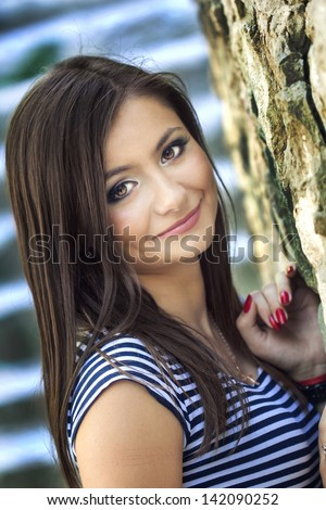 a close up portrait of a brunette beautiful girl - stock photo