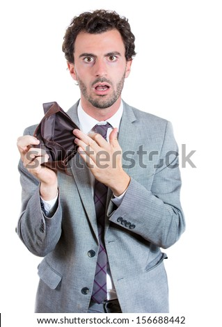 A close-up portrait of a shocked, surprised speechless man, businessman holding an empty wallet isolated on a white background. Bankruptcy financial difficulties concept. Job loss. - stock photo
