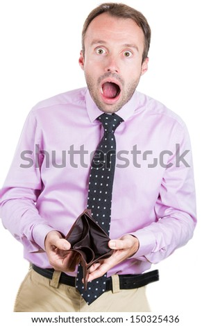 A close-up portrait of a shocked, surprised speechless man holding an empty wallet and looking at you isolated on a white background. Bankruptcy, financial difficulties concept. - stock photo