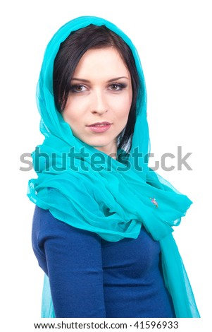 A close-up portrait of a young brunette woman wearing a turquoise headscarf isolated on white background - stock photo