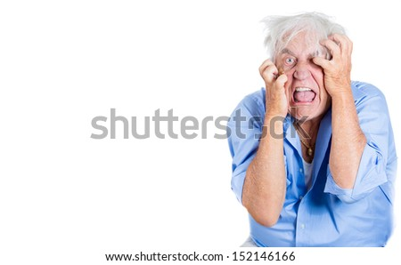 A close-up portrait of an elderly, desperate, mad, looking crazy, desperate man, pulling out his hair, isolated on a white background with copy space. Extremes of human emotions. - stock photo