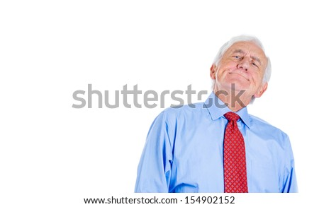 A close-up portrait of an old executive, grandfather, corporate employee, looking arrogant and very demanding, in disbelief, isolated on a white background with copy space. - stock photo