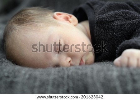 A close up shot of a baby sleeping