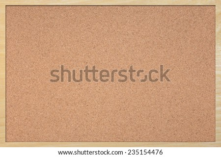 A close up shot of a cork notice board - stock photo