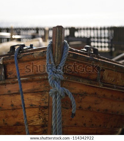 A close up shot of a moored rowing boat - stock photo